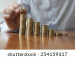 finances  person stacking euro... | Shutterstock . vector #254159317