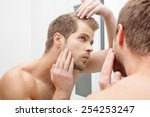 man standing in front of mirror ... | Shutterstock . vector #254253247