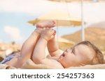 Happy Baby On The Beach Sunbed...
