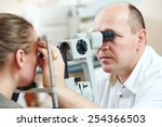 Постер, плакат: Optometry concept Male optometrist