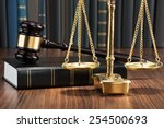 wooden gavel on book with