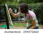 Young Caucasian Woman Painting...
