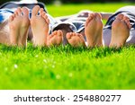 family relaxing on the grass | Shutterstock . vector #254880277