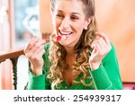 young woman eating fruit cake... | Shutterstock . vector #254939317