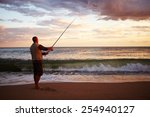 Man Casting A Fishing Line Int...