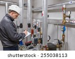 technician inspecting heating...