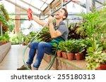 Happy Gardener Singing In Wate...