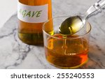 agave syrup pouring on a glass. ...   Shutterstock . vector #255240553