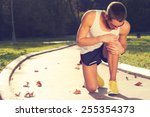 jogging injury. | Shutterstock . vector #255354373