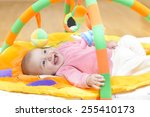 innocent baby smiling and...   Shutterstock . vector #255410173