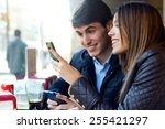 portrait of young couple using... | Shutterstock . vector #255421297
