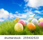Decorated Easter Eggs In Grass...