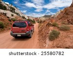 SUV driving the Cottonwood Canyon Road in Grand Staircase Escalante National Park, Utah - stock photo