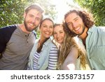happy friends taking a selfie... | Shutterstock . vector #255873157