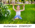 happy child playing in a spring ... | Shutterstock . vector #255895297
