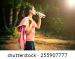 a girl drinks water after sport | Shutterstock . vector #255907777