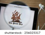 Small photo of CHIANGMAI, THAILAND - February 26, 2015: Photo of the new Pirate Bay homepage on a ipad monitor screen through a magnifying glass.