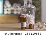 bottles with homeopathy globules   Shutterstock . vector #256119553