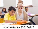 teacher and pupil smiling at... | Shutterstock . vector #256184113