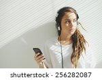 teenage girl in headphones...   Shutterstock . vector #256282087