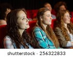 young friends watching a film... | Shutterstock . vector #256322833