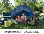 happy family on a camping trip... | Shutterstock . vector #256329337