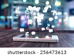 white smart phone on a wooden... | Shutterstock . vector #256473613