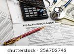 health care costs. stethoscope...   Shutterstock . vector #256703743
