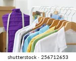 clothes hang on a shelf in ...   Shutterstock . vector #256712653