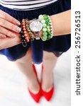 stylish bracelets and clock on...   Shutterstock . vector #256726513