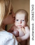 mother with baby at home.... | Shutterstock . vector #256827643