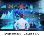 businessman looking to drawing... | Shutterstock . vector #256855477