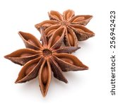 Small photo of Star anise spice fruits and seeds isolated on white background closeup
