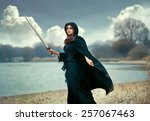 the beautiful gothic girl holds ... | Shutterstock . vector #257067463