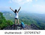 cheering woman hiker open arms... | Shutterstock . vector #257093767