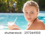 little blond girl with cocktail ... | Shutterstock . vector #257264503
