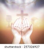 hands of man praying over... | Shutterstock . vector #257326927
