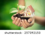 child holding house and tree in ... | Shutterstock . vector #257392153