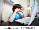 distance learning  a boy with... | Shutterstock . vector #257402833