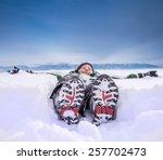 Boy Lying In Deep Snow On...
