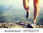young woman hiker legs climbing ... | Shutterstock . vector #257922173