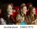 young friends watching a film... | Shutterstock . vector #258017573