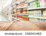 wood floor and supermarket blur ...   Shutterstock . vector #258041483