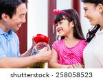 Chinese Family Saving Money Fo...