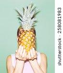 Girl Holding Pineapple....