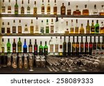 backlit bottles and glassware... | Shutterstock . vector #258089333
