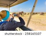 woman on african wildlife... | Shutterstock . vector #258165107