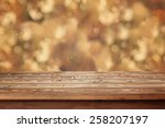 Empty Wooden Table Against A...