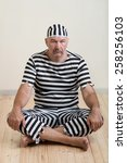 Small photo of portrait of a man prisoner in prison garb