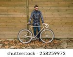 hipster man with his fixie bike ... | Shutterstock . vector #258259973